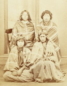 Studio portrait of four young Maori women, circa 1867