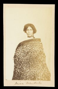 Photographic portrait of a Maori woman, Mina Maukaki, wearing a flax cloakPhotographer unknown.# 8026