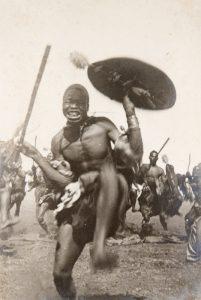 Zulu warriors and European gold miners, Klerksdorp, Transvaal, circa 1895.[FRAZIER]# 4126