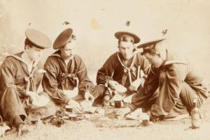 # 15321  MUMEYA, M.  A game of draw poker on the beach. Photo taken at Hong Kong, China, Sept. 17 1898.