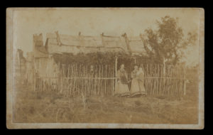 # 15467  BOAG, William  Pioneer settlers outside a slab and bark hut, probably Stanthorpe district, southeast Queensland, 1872-73