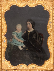 # 15676  GLAISTER, Thomas Skelton (1825-1904)  Half plate tinted ambrotype portrait of a mother and her young son, Sydney, late 1850s